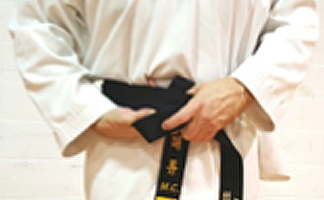 How to tie your Taekwondo belt Step 3